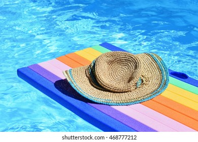 Pool with clean water. Background for summer holiday,  traveling and vacation. Air mattress - lilo.