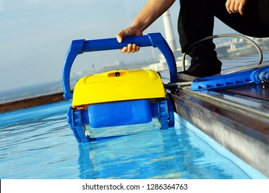 Pool cleaner during his work. Cleaning robot for cleaning the botton of swimming pools.