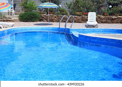 Pool with clear blue water on sunny day in residential the yard