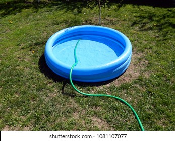 The pool is filled with water inflatable round blue