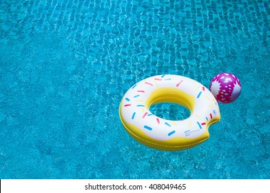 Pool float ring floating on blue swimming pool