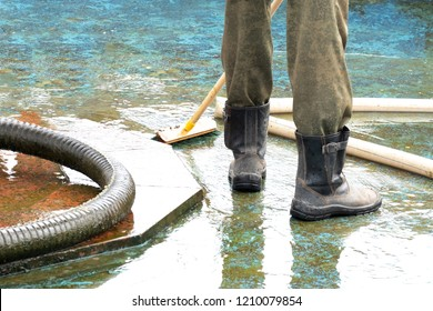 pool or fountain cleaner boots, brush removes debris from the surface, corrugated hose and old painted surface