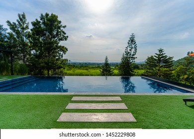 the pool front view home in the nature with outdoor nature