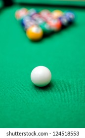 Pool game balls on green felt table