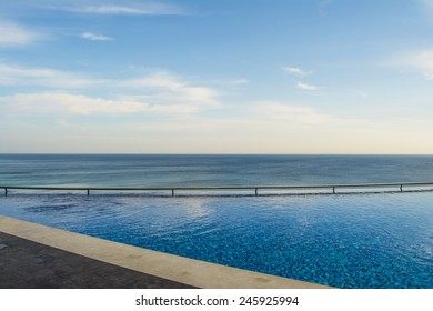 Pool with handrails and sea views
