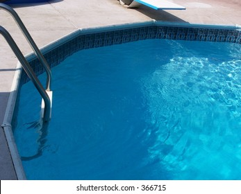 pool with ladder and diving board