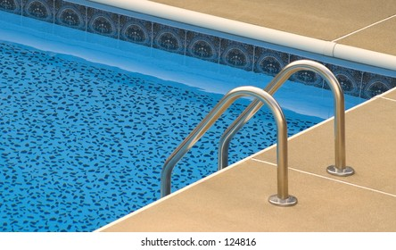 Pool ladder and swimming pool.