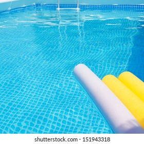 pool noodles floating on the water