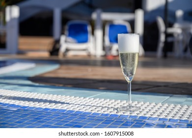Pool party with one glass of bubbles white champagne or cava wine, romantic event on all inclusive holidays, relax on own villa