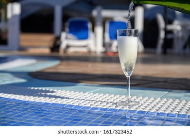 Pool party with one glass of bubbles white cava wine, romantic event on all inclusive holidays, relax on own villa