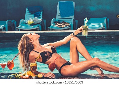 Pool party relax in spa resort. Cocktail with fruit at sexy girl in pool on maldives. Fashion woman with refresh alcohol in miami. Drink fresh vitamin juice, diet. Summer vacation and swimming at sea