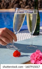 Pool party with two glasses of bubbles white champagne or cava wine, romantic event on all inclusive holidays, relax on own villa