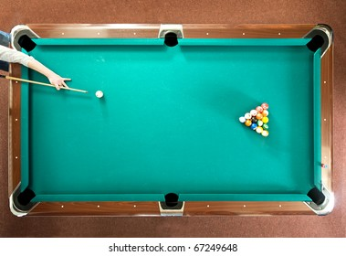 Pool player ready for the break, seen from above