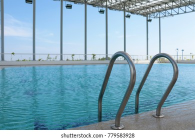 Pool stairs in swimming pool and sky view