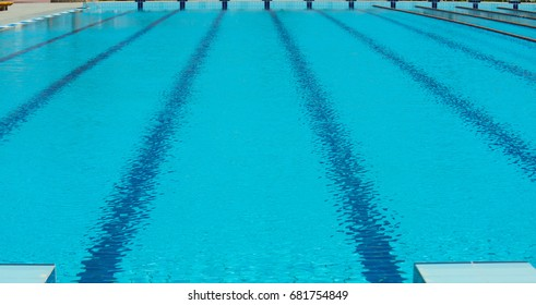 Swimming pool lane lines background Swimming Lesson Pool For Swimming With Epmty Lanes Blue Tarnsparent Water And Rope Lines Sport Race Competition Wikipedia Top View Swimming Pool Lanes Stock Photo edit Now 663411931