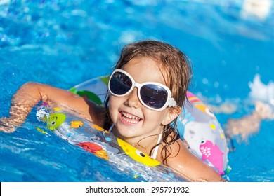 Pool, swimwear, sunlight.