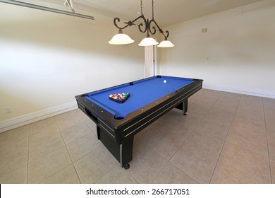 A pool table in a garage in Florida