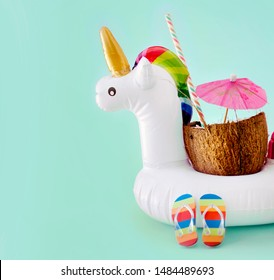 Pool toy on a pastel background with Coconut, summer vibes concept