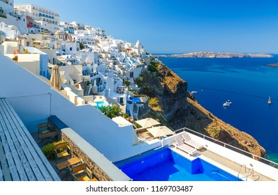 Pool and a view sunny morning view of Santorini island. Picturesque spring scene of the famous Greek resort Thira, Greece, Europe. Traveling concept background.
