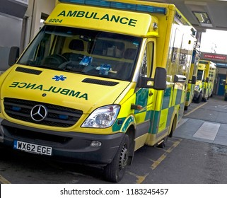 Poole, Dorset/UK -  February 15 2015: A row of three NHS ambulances in perspective waiting outside the A&E department of a hospital in the UK