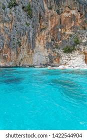 Pools of Venus (Piscine di Venere) below high limestone cliffs, Gulf of Orosei, Gennargentu National Park, Sardinia - Italy. 20th of May 2019