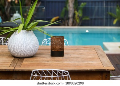 Poolside decor with plants and outdoor dining