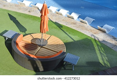 Poolside round table with sofa, seen from above