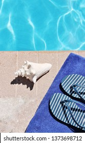 Poolside swimming pool blue water surface holiday vacation scenic swimming pool travel summer holiday sandals  shoes stock photo, stock, photograph, image, picture