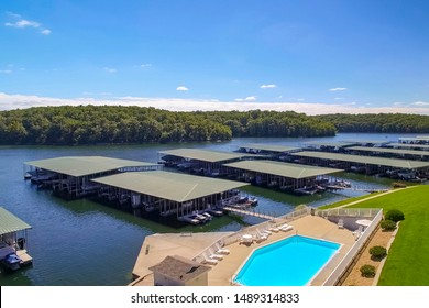 Poolside view of boats docked at lakeside condo on a bright sunny summer day at Lake of the Ozarks Missouri