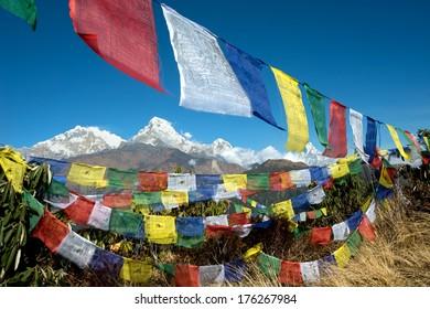 Poon HIll View of Annapurna Range through prayer flags