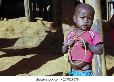 Poor african boy with a string - is he trying to attempt a suecide?
