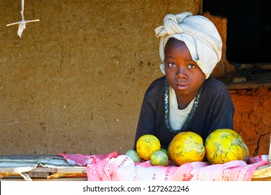 Poor African girl selling fruits - Madagascar