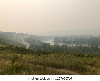 Poor air quality and reduced visibility over Calgary, Alberta due to forest fires in British Columbia