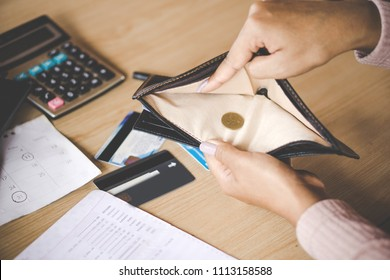poor Asian woman hand open empty purse with only one coin left bankrupt broke after credit card payday