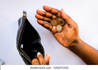 Poor Black African American woman showing open empty wallet and coins in hand for money financial problem bankrupt jobless, broke after credit card payday jobless, broke, bankruptcy, debt