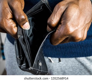 Poor Black man with empty wallet. African American Man showing open empty wallet for money financial problem bankrupt jobless, broke after credit card payday jobless, broke, bankruptcy, debt