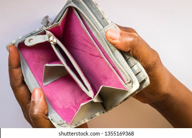 Poor Black woman with empty purse or wallet with no money. African American woman showing open empty wallet for money financial problem bankrupt, debt, credit loss, personal finance concept