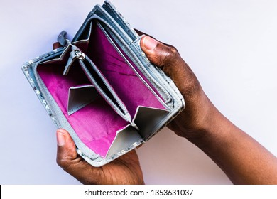 Poor Black woman with empty wallet. African American woman showing open empty wallet for money financial problem bankrupt jobless, broke after credit card payday jobless, broke, bankruptcy, debt