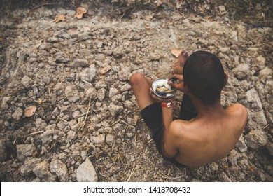 poor child or beggar begging you for help sitting at dirty slum. concept for poverty or hunger people,human rights,donate and charity for underprivileged children in third world