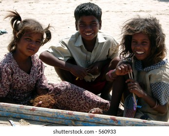 poor children posing for a photograph