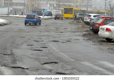 Poor condition of the road surface. Winter season. Wet and foggy weather. Residential area of the city of Kiev. January 30, 2019. Kiev,Ukraine