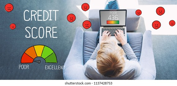 Poor Credit Score with man using a laptop in a modern gray chair