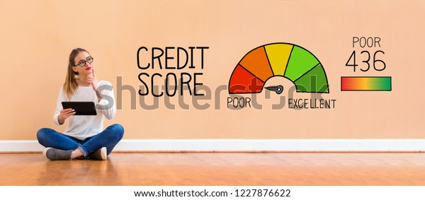 Poor credit score with young woman holding a tablet computer