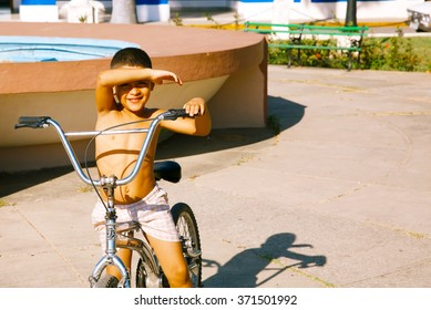 The poor Cuban boy on a bicycle