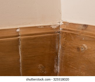 Poor diy workmanship - badly fitted wooden skirting boards with butted joints
