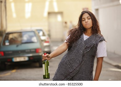 poor and drunk young girl  walking in city street