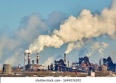 Poor environment in the city. Environmental disaster. Harmful emissions into the environment. Smoke and smog. Pollution of atmosphere by plant factory. Exhaust gases.