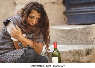 poor homeless drunk woman in cold weather