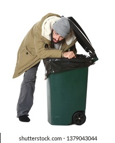Poor homeless man digging in trash bin isolated on white
