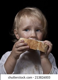poor hungry child eating bread